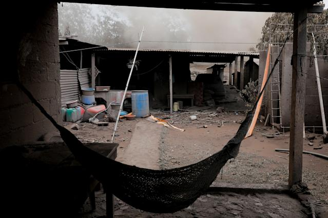<p>A hammock covered with ash hangs afters the eruption of the Fuego volcano in San Miguel Los Lotes in Escuintla, Guatemala, June 6, 2018. (Photo: Carlos Jasso/Reuters) </p>