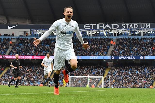 <p>Swansea City's Gylfi Sigurdsson celebrates scoring the equaliser for Swansea City during the Premier League match between Manchester City and Swansea City at the Etihad Stadium on February 5, Manchester, England. </p>