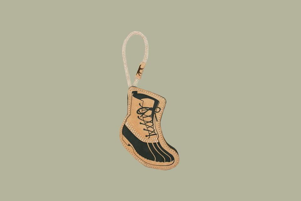 """<p>Under normal circumstances, you would dissuade your dog from chewing on shoes. If you have a chewer at home, this toy just might spare your favorite pair. This boot is made with vegetable-tanned leather and reinforced layers of natural wool-felt stitched together with no glue, toxic, or artificial substances.</p> <p><strong><em>Shop Now: </em></strong><em>Tall Tails Natural Leather Boot Tug Toy, $17, </em><a href=""""https://www.talltailsdog.com/natural-wool-boot-toy.html"""" rel=""""nofollow noopener"""" target=""""_blank"""" data-ylk=""""slk:talltailsdog.com"""" class=""""link rapid-noclick-resp""""><em>talltailsdog.com</em></a><em>.</em></p>"""
