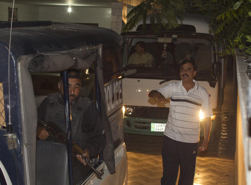 Police officers escort a vehicle carrying the family of Osama bin Laden, in Islamabad, Pakistan on Thursday, April 26, 2012. A minivan carrying the three widows and children of Bin Laden has left the house where they have been staying in Islamabad and is en route to the airport, from where they will be deported to Saudi Arabia, officials and witness said. (AP Photo/B.K. Bangash)