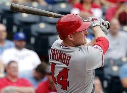 Los Angeles Angels' Mark Trumbo hits a three-run home run during the second inning of a baseball game against the Kansas City Royals, Sunday, Sept. 16, 2012, in Kansas City, Mo. (AP Photo/Charlie Riedel)