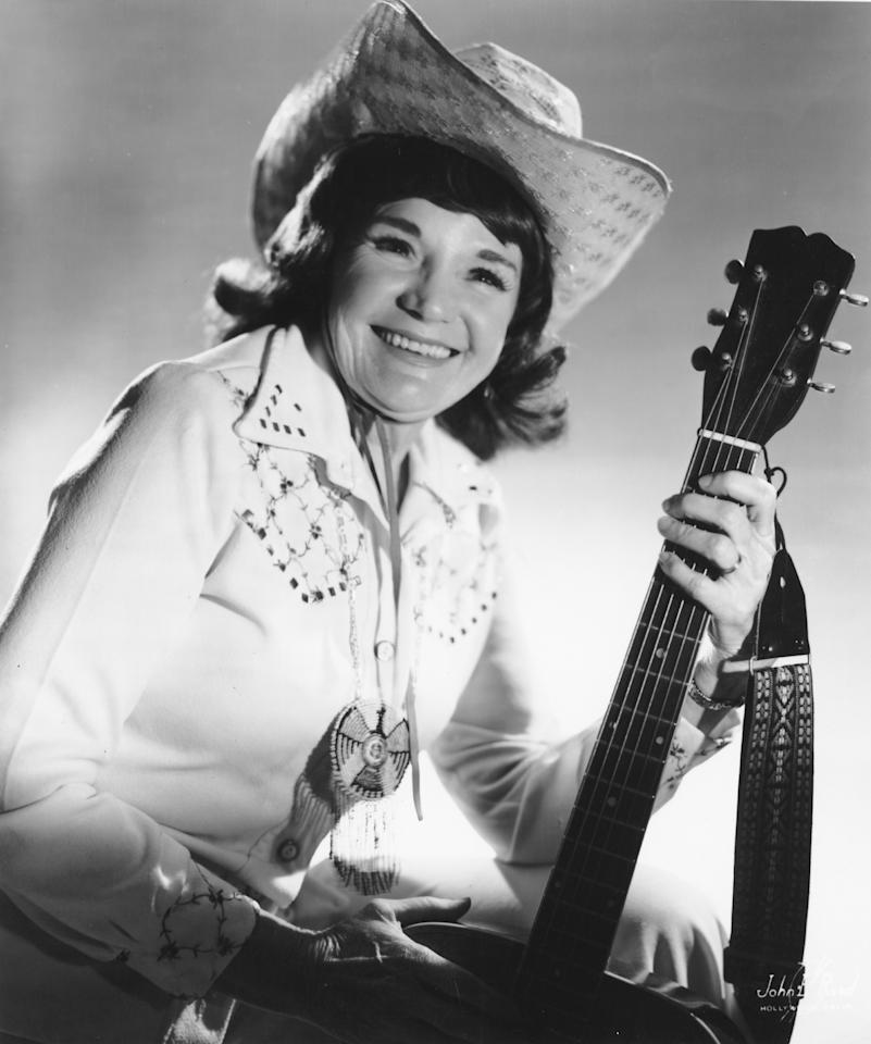"""<p>Country music's <i>other</i> Patsy is this Arkansas crooner who rose to fame in the 1930s thanks to a memorable voice and an ability to hit all the high notes. Born as Rubye Blevins in Hot Springs, Arkansas in 1914, she grew up listening to Jimmie Rodgers's, incorporating some of his famous yodels into her own music. She changed her name to Patsy Montana in 1931, and started writing and performing songs like """"I Want to Be a Cowboy's Sweetheart"""" and """"Rodeo Sunset"""". She starred alongside Gene Autry in the film <i>Colorado Sunset</i> and performed with Waylon Jennings, before he got famous. She was inducted into the Country Music Hall of Fame in 1996.</p>"""