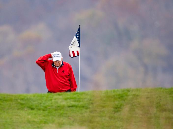 President Donald Trump plays golf for the 143rd time since becoming president at the Trump National Golf Club in Sterling, Virginia, USA, 21 November 2020 (EPA)