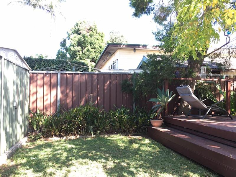 Photo of Lee and Linda Solomons' fence before DIY table fold-down job