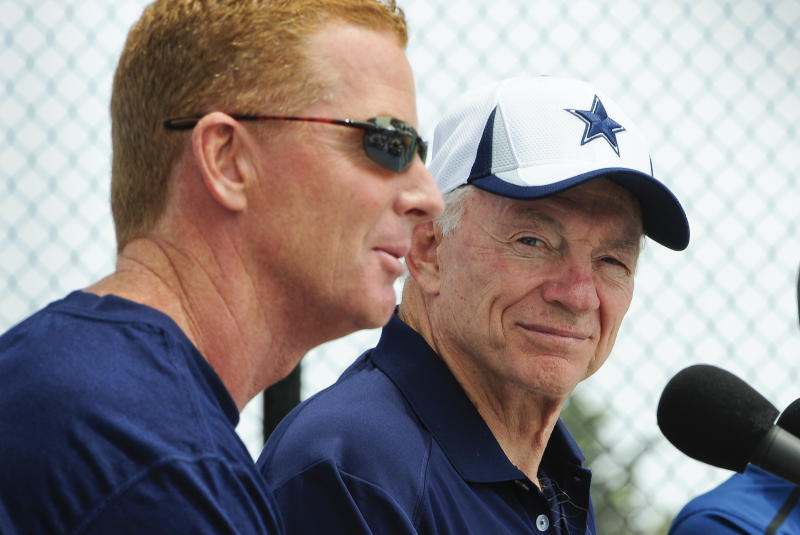 Dallas Cowboys owner Jerry Jones, right, watches as head coach Jason Garrett, left, answers a question from members of the media during the State of the Cowboys address at NFL football training camp on Saturday, July 20, 2013, in Oxnard, Calif. (AP Photo/Gus Ruelas)