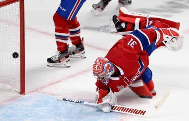 Montreal Canadiens goaltender Carey Price watches the puck go in during Game 4 of the Stanley Cup final against the Tampa Bay Lightning on July 5. (Ryan Remiorz/Canadian Press - image credit)