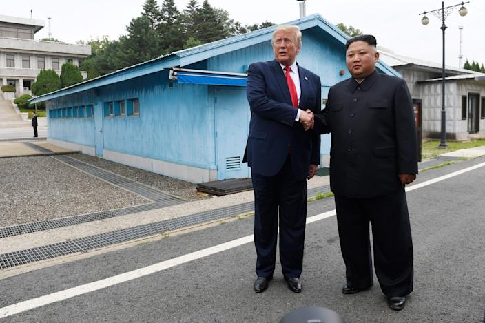 President Donald Trump meets with North Korean leader Kim Jong Un at the Demilitarized Zone between North and South Korea on June 30, 2019.