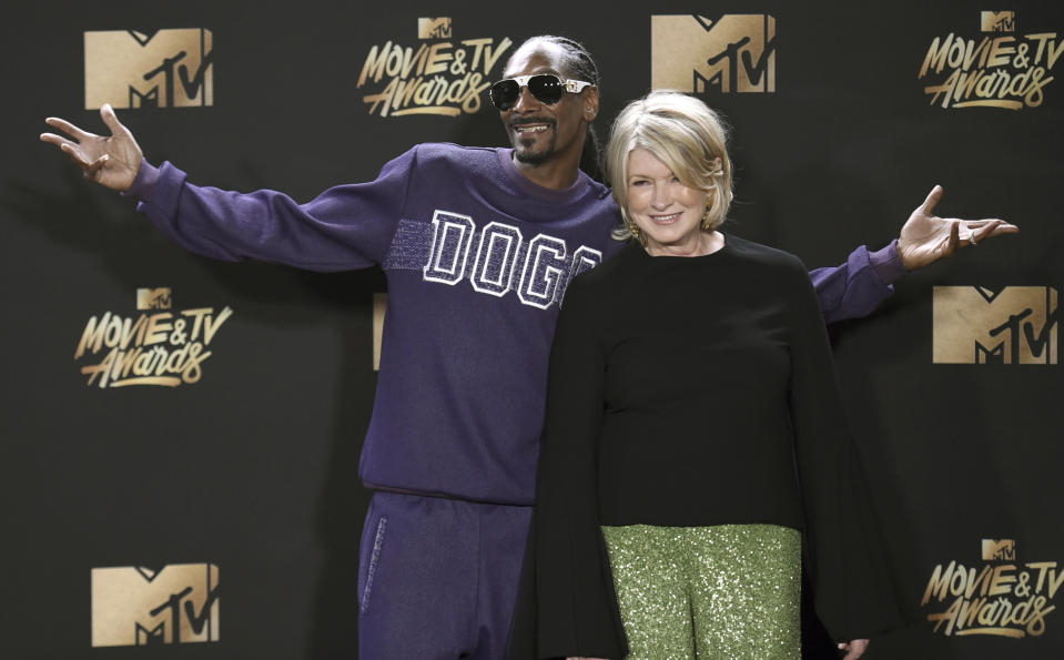 "FILE - In this May 7, 2017 file photo, Snoop Dogg, left, and Martha Stewart pose in the press room at the MTV Movie and TV Awards in Los Angeles. The domestic diva who brought us hemp yarn is now partnering with Canada's Canopy Growth Corp. to develop new products containing CBD, a compound derived from hemp and marijuana that doesn't cause a high. Stewart's tie-up with Canopy may not be a surprise to her fans. In 2015, she baked brownies on ""The Martha Stewart Show"" with marijuana aficionado Snoop Dogg, and hinted that Snoop could add a little weed if he wanted to. (Photo by Richard Shotwell/Invision/AP, File)"