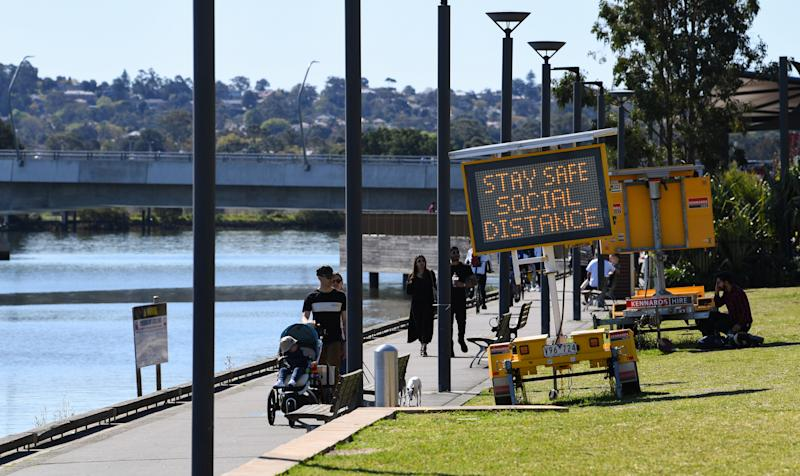 SYDNEY, AUSTRALIA - SEPTEMBER 12: People walk in a park in the suburb of Rhodes on September 12, 2020 in Sydney, Australia. Six new COVID-19 cases were recorded in NSW in the last 24 hour reporting period with one being in hotel quarantine and five linked to a known case or clusters. The total deaths in Australia from COVID-19 now stands at 797. (Photo by James D. Morgan/Getty Images)