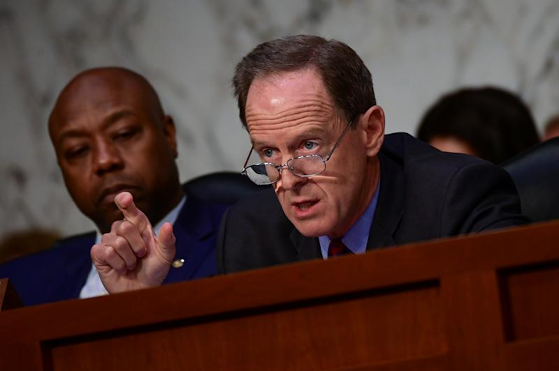"""Pat Toomey (R-PA) questions David Marcus, head of Facebook's Calibra (digital wallet service), during testimony before a Senate Banking, Housing and Urban Affairs Committee hearing on """"Examining Facebook's Proposed Digital Currency and Data Privacy Considerations"""" on Capitol hill in Washington, U.S., July 16, 2019. REUTERS/Erin Scott"""