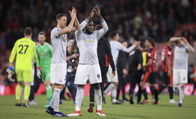 Manchester United's Romelu Lukaku, center, and Nemanja Matic, left, applaud the fans after the Premier League match at the Vitality Stadium, Bournemouth, Wednesday April 18, 2018. (Adam Davy/PA via AP)