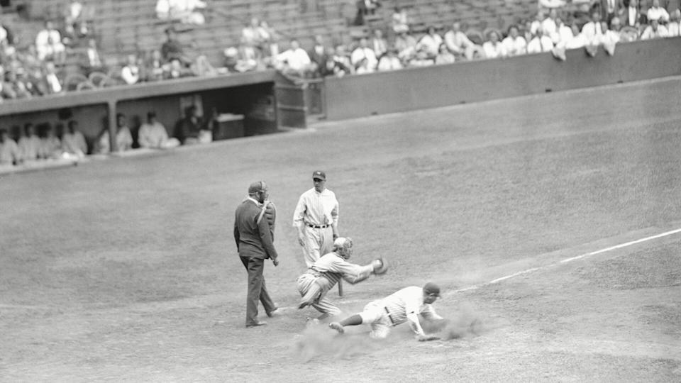 Mandatory Credit: Photo by AP/Shutterstock (6673427a)New York Yankees Babe Ruth slides into home base safe, as Lefty Stewart was careless in his delivery, in Yankee Stadium.