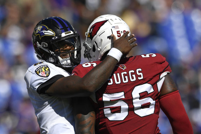 Baltimore Ravens quarterback Lamar Jackson, left, embraces Arizona Cardinals outside linebacker Terrell Suggs after Suggs tackled Jackson on a play in the second half of an NFL football game, Sunday, Sept. 15, 2019, in Baltimore. (AP Photo/Nick Wass)
