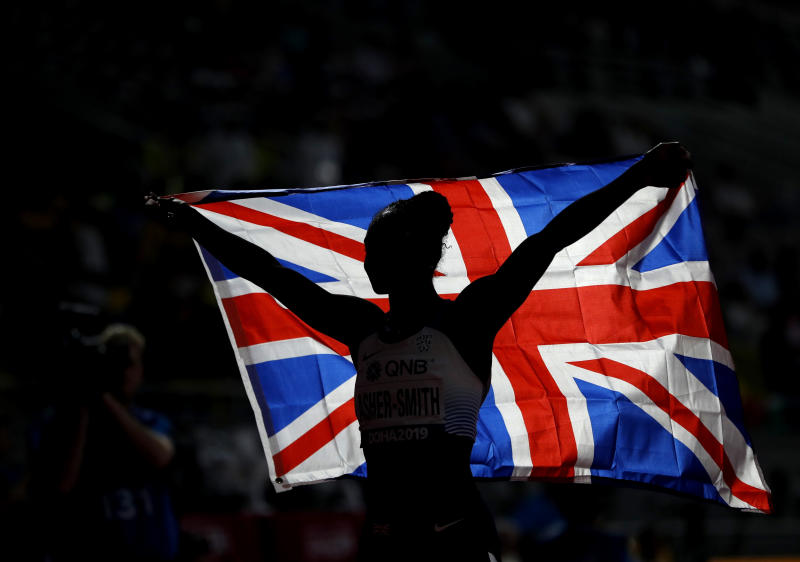 Dina Asher-Smith of Great Britain celebrates winning the gold medal in the women's 200 meter final at the World Athletics Championships in Doha, Qatar, Wednesday, Oct. 2, 2019. (AP Photo/Petr David Josek)