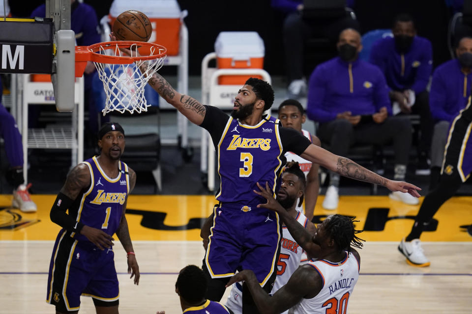 Los Angeles Lakers forward Anthony Davis (3) shoots against the New York Knicks during the first quarter of a basketball game Tuesday, May 11, 2021, in Los Angeles. (AP Photo/Ashley Landis)