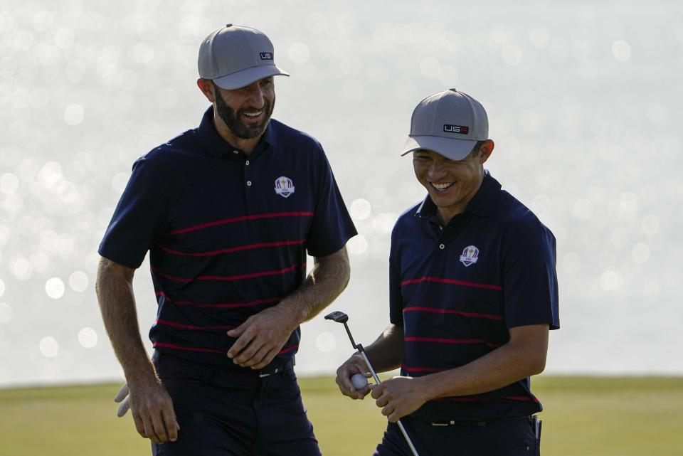 Team USA's Dustin Johnson and Team USA's Collin Morikawa react on the eighth hole during a foursome match the Ryder Cup at the Whistling Straits Golf Course Friday, Sept. 24, 2021, in Sheboygan, Wis. (AP Photo/Jeff Roberson)