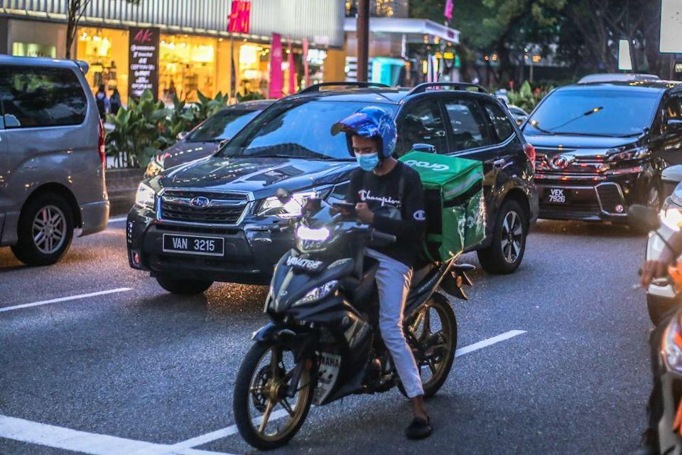 A GrabFood rider is pictured in Kuala Lumpur 16, 2020. — Picture by Firdaus Latif