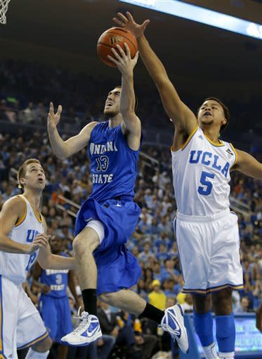 Indiana State's Jake Odum, left, drives to the basket as he is defended by UCLA's Kyle Anderson during the first half of an NCAA college basketball game in Los Angeles, Friday, Nov. 9, 2012. (AP Photo/Jae C. Hong)