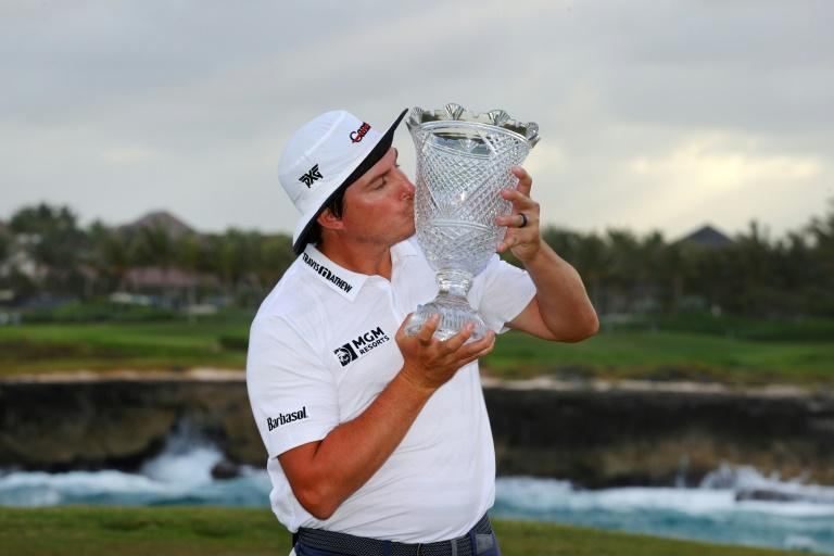Joel Dahmen, wearing his signature #endcancer bucket hat, with the trophy after winning the Corales Puntacana Resort and Club Championship in the Dominican Republic