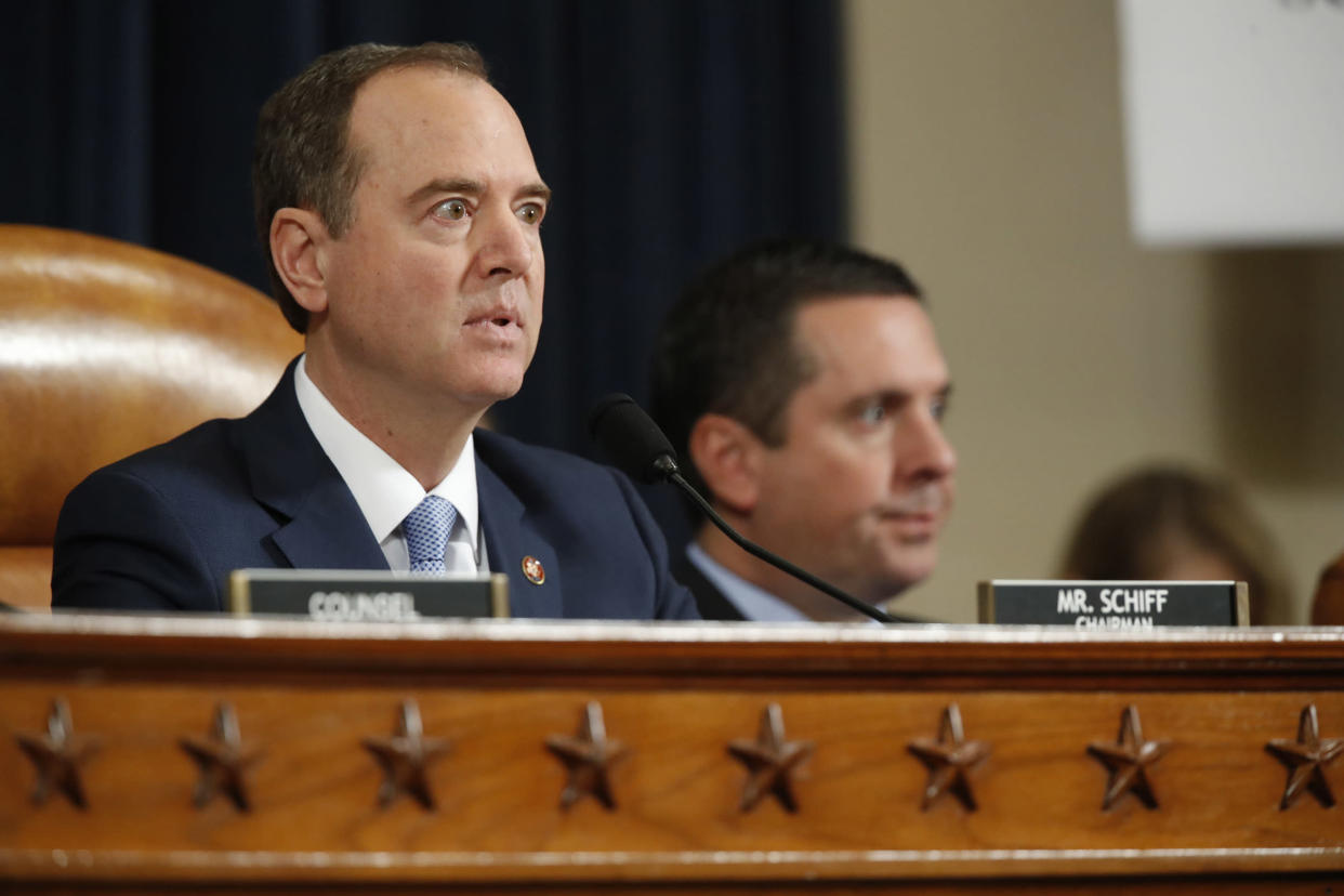House Intelligence Committee Chairmen Rep. Adam Schiff, D-Calif., left, gives opening remarks as ranking member Rep. Devin Nunes, R-Calif., left, looks on, before former Ambassador to Ukraine Marie Yovanovitch testifies before the House Intelligence Committee on Capitol Hill in Washington, on Nov. 15, 2019. | Alex Brandon—AP