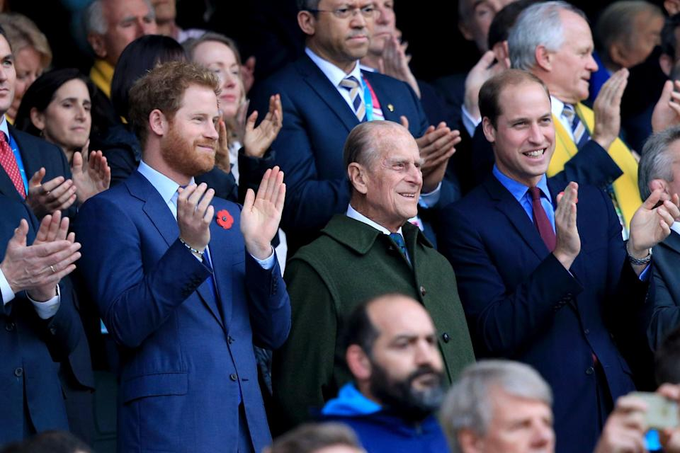 William and Harry, pictured here with Philip, will not walk side by side in the funeral processionPA
