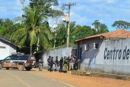 Policemen and soldiers are seen in front of a prison after a riot, in the city of Altamira