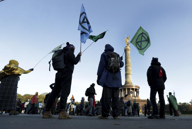 Supporters of the 'Extinction Rebellion' movement block a road at the Victory Column in Berlin, Germany, Oct. 7, 2019. (Photo: Michael Sohn/AP)