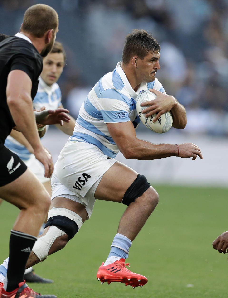 """FILE - In this Saturday, Nov. 14, 2020, file photo Argentina's Pablo Matera makes a run during the Tri-Nations rugby test between Argentina and New Zealand at Bankwest Stadium in Sydney, Australia. Matera has been stripped of the captaincy of the Argentina national rugby team and suspended along with two teammates over historic social media posts which have been deemed """"discriminatory and xenophobic."""" (AP Photo/Rick Rycroft, File)"""