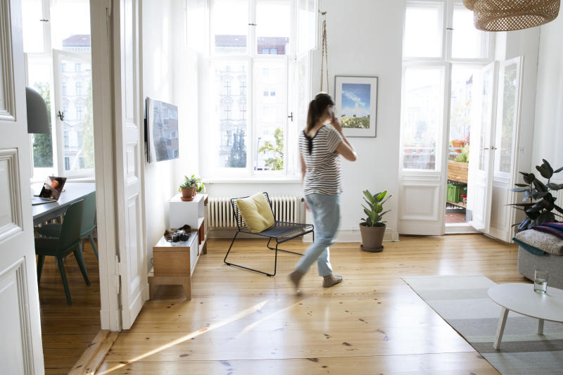 Woman walking around her Airbnb
