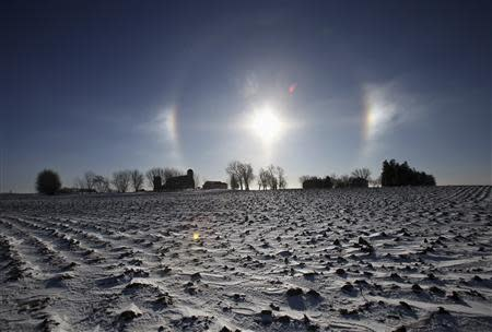 """A """"sun dog"""" atmospheric phenomenon appears over a farm in southern Minnesota, January 27, 2014. REUTERS/Eric Miller"""