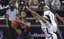 Mississippi guard Mimi Reid (2) shoots as South Carolina guard Destanni Henderson (3) defends during an NCAA college basketball game in Columbia, S.C., Thursday, Feb. 25, 2021. (Tracy Glantz/The State via AP)
