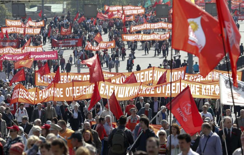 Members of Russia's Communist party carry banners and flags during a May Day rally in Moscow