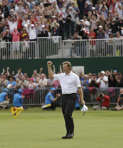 Ernie Els of South Africa reacts after putting on the 18 green at Royal Lytham & St Annes golf club during the final round of the British Open Golf Championship, Lytham St Annes, England Sunday, July 22, 2012. (AP Photo/Peter Morrison)