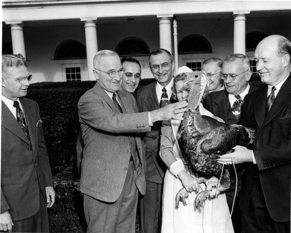 """<p>The custom of presenting a Thanksgiving turkey to the standing president began with Harry S. Truman in 1947. However, no evidence suggests he actually pardoned it. In fact, in 1948 Truman made a point of saying the turkey <a href=""""http://www.history.com/news/a-brief-history-of-the-presidential-turkey-pardon"""" rel=""""nofollow noopener"""" target=""""_blank"""" data-ylk=""""slk:""""would come in handy,"""""""" class=""""link rapid-noclick-resp"""">""""would come in handy,""""</a> not for Thanksgiving festivities but for the 25-person feast he planned for Christmas. Here he is, a year later in 1949, receiving a turkey from the Poultry and Egg National Board. <i>(Photo: Harry S. Truman Presidential Library)</i></p>"""