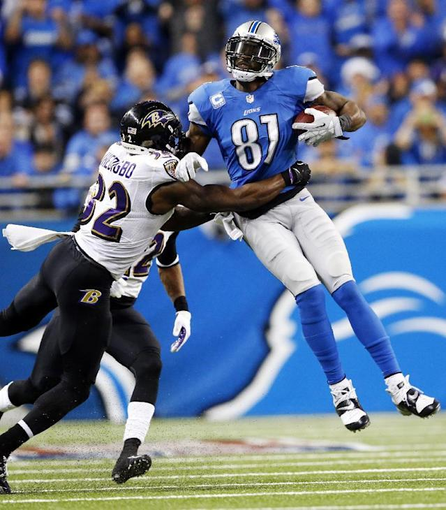 Baltimore Ravens strong safety James Ihedigbo (32) tackles Detroit Lions wide receiver Calvin Johnson (81) during the third quarter of an NFL football game in Detroit, Monday, Dec. 16, 2013. (AP Photo/Paul Sancya)