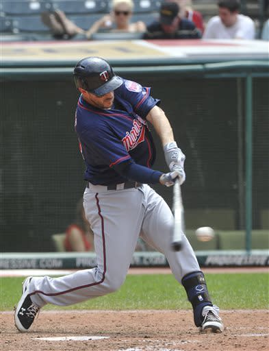 Minnesota Twins' Trevor Plouffe hits an RBI-single off Cleveland Indians pitcher Carlos Carrasco during the fifth inning of a baseball game at Progressive Field in Cleveland, Sunday, June 23, 2013. AP Photo/Phil Long)