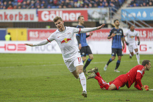 Leipzig's Timo Werner celebrates his side's third goal during a German Bundesliga soccer match between SC Padernborn and RB Leipzig in Paderborn, Germany, Saturday, Nov.30, 2019. (Friso Gentsch/dpa via AP)