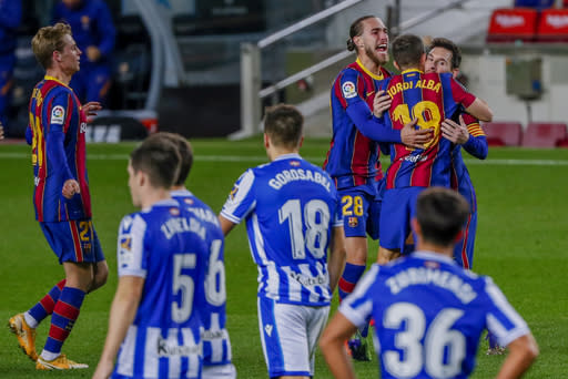 Barcelona's Jordi Alba, second right, celebrates after scoring his side's first goal during the Spanish La Liga soccer match between FC Barcelona and Real Sociedad at the Camp Nou stadium in Barcelona, Spain, Wednesday, Dec. 16, 2020. (AP Photo/Joan Monfort)