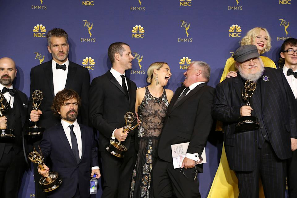 "George R.R. Martin and the cast and crew of ""Game of Thrones"" pose in the press room with the award for outstanding drama series for ""Game of Thrones"" at the 70th Primetime Emmy Awards on Monday, Sept. 17, 2018, at the Microsoft Theater in Los Angeles. (Photo by Willy Sanjuan/Invision for the Television Academy/AP Images)"