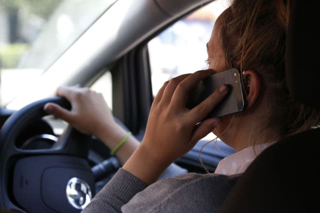 NOTE POSED BY MODEL File photo dated 13/08/14 of a woman using a mobile phone while driving. Half of Britons (50\%) believe all use of mobiles while driving is dangerous, Government research has found.