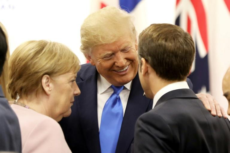US President Donald Trump was all smiles with Germany's Chancellor Angela Merkel and France's President Emmanuel Macron at a June meeting in Japan (AFP Photo/Dominique JACOVIDES)