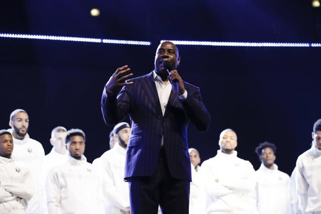 Magic Johnson speaks during a tribute to former NBA All-Star Kobe Bryant and his daughter Gianna who were killed in a helicopter crash on Jan. 26, 2020, before the NBA All-Star basketball game Sunday, Feb. 16, 2020, in Chicago. (AP Photo/Nam Huh)