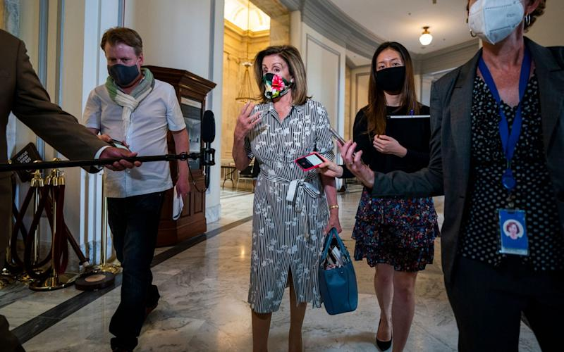 Speaker of the House Nancy Pelosi speaks to reporters after a TV interview in the Russell Rotunda on Capitol Hill in Washington, DC, USA, 12 August - JIM LO SCALZO/EPA-EFE/Shutterstock