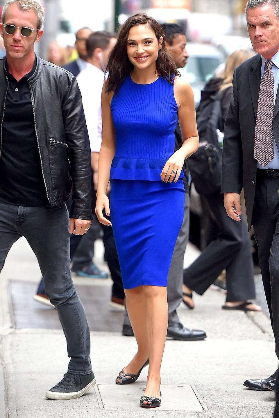 <p>Good morning, Gal! The actress (pictured with her husband of eight years, Yaron Versano) wore a blue peplum top and skirt from Diane von Furstenberg for an appearance on <i>Good Morning America</i>. Of course, she wore flats. (Photo by Josiah Kamau/BuzzFoto via Getty Images) </p>