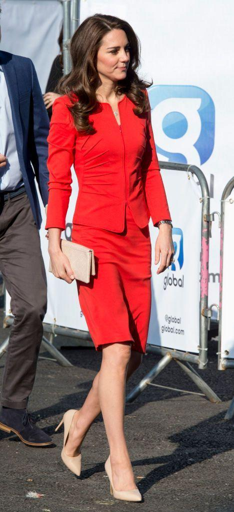 <p>In support of Heads Together, a cause that focuses on mental health issues, the Duke and Duchess of Cambridge attended the opening of The Global Academy. The new school will specialize in preparing children for a profession in broadcast and digital media. For the event, the Duchess wore a scarlet red Armani skirt suit, and paired the outfit with muted nude accents.</p>