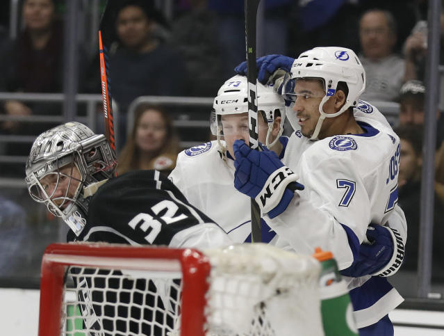 Tampa Bay Lightning's Mathieu Joseph (7) celebrates his goal with teammate Adam Erne, center, next to Los Angeles Kings goaltender Jonathan Quick, left, during the third period of an NHL hockey game Thursday, Jan. 3, 2019, in Los Angeles. (AP Photo/Marcio Jose Sanchez)