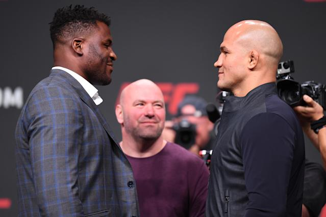Francis Ngannou and Junior Dos Santos face off during a news conference inside State Farm Arena on April 12, 2019 in Atlanta. (Getty Images)