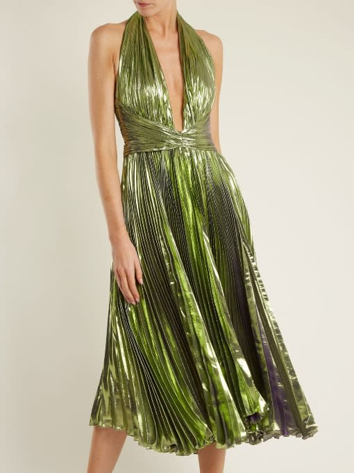 """<p><em>$1,619, Matches Fashion</em></p><p><a rel=""""nofollow noopener"""" href=""""https://www.matchesfashion.com/us/products/Maria-Lucia-Hohan-Ryna-halterneck-pleated-lam%C3%A9-midi-dress-1170753"""" target=""""_blank"""" data-ylk=""""slk:Buy Now"""" class=""""link rapid-noclick-resp"""">Buy Now</a></p>"""