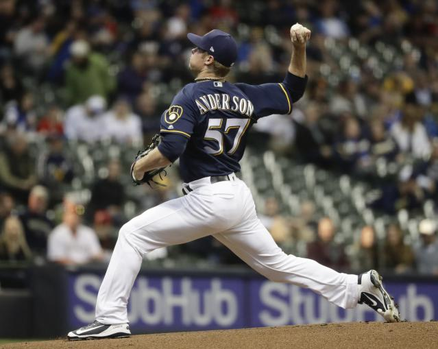 Milwaukee Brewers starting pitcher Chase Anderson throws during the first inning of a baseball game against the Miami Marlins Thursday, April 19, 2018, in Milwaukee. (AP Photo/Morry Gash)