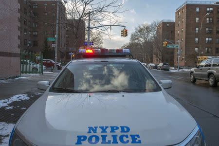 A New York Police Department patrol vehicle is seen near the Marcy Houses public housing development in the Brooklyn borough of New York January 9, 2015. REUTERS/Stephanie Keith